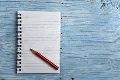 Notepad with red pencil Royalty Free Stock Images
