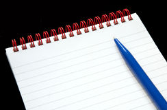 Notepad with red rings. Royalty Free Stock Photo
