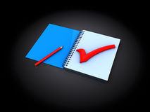 Notepad with red tick Stock Photos