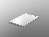 Notepad on reflective background Stock Photos