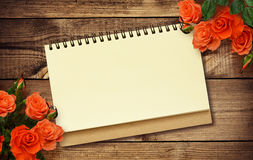 Notepad and roses Royalty Free Stock Photos