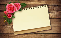 Notepad and roses Stock Photography