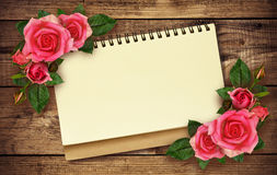 Notepad and roses Royalty Free Stock Image
