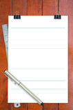 Notepad, ruler and pen on desk Royalty Free Stock Image