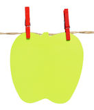 Notepad shaped apple hanging from a rope Stock Photo