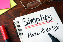 Notepad with sign simplify. Stock Photography