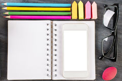 Notepad, smartphone and supplies Stock Photo