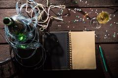 Notepad som skriver upplösningar för ` s för nytt år Royaltyfri Fotografi