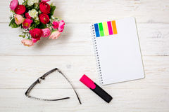 Notepad and spectacles on white boards Stock Photography