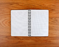 Notepad with a spiral binding and checkered sheets Royalty Free Stock Photo