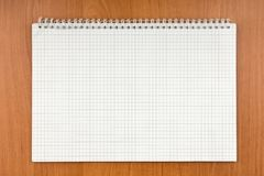 Notepad on a spiral lying on a table. Stock Photo