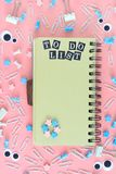 Notepad on springs with brown pages. Inscription To Do List. Stationery is in disarray. The asterisks and pupal eyes are. Chaotically scattered. Bright photo stock photos