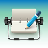 Notepad on stand with pencil Stock Image