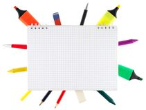 Notepad with stationary objects Royalty Free Stock Photo