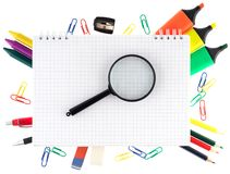 Notepad with stationary objects Royalty Free Stock Images