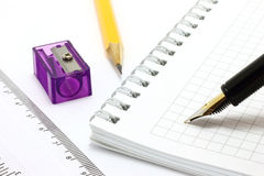 Notepad with stationary objects Stock Photo