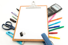 Notepad with stationary objects in the background Royalty Free Stock Photography