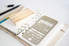 Notepad and stationery on white background. Planner for business and study. Fans of stationery.  stock image