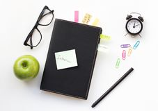 Notepad with sticky note stock images