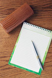Notepad on the table Royalty Free Stock Photos