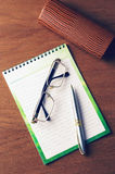 Notepad on the table Royalty Free Stock Image