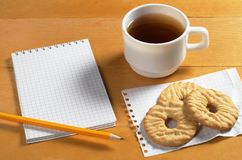 Notepad, tea and cookies Royalty Free Stock Photo