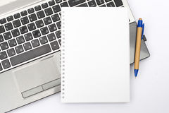 Notepad without text on the laptop keyboard. For business tasks and presentations. Business concept. royalty free stock photos