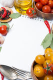 Notepad to write recipes, tomatoes and spices Stock Images