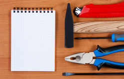 Notepad and tool top view. Royalty Free Stock Photography