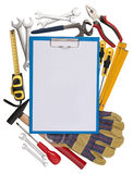 Notepad with tools. In the background Royalty Free Stock Images
