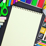 Notepad and various school supplies. Notepad for recording and various school supplies Royalty Free Stock Photos