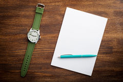 Notepad and watches on the desk Stock Photography