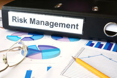 Graphs and file folder with label Risk Management.  Royalty Free Stock Photo