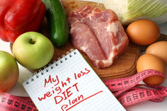 Notepad with weight loss diet plan Stock Photo