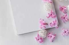 Notepad on white wooden background. Pink hyacinth flowers on the table. stock image