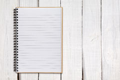 Notepad on white wood Stock Image