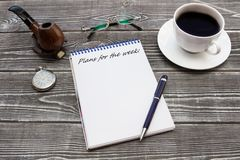 Notepad With The Inscription, Pen: `Plans For The Week:` With A Cup Of Coffee, A Pipe, Glasses And A Pocket Watch Stock Photo