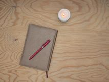 Notepad with wood table handle. royalty free stock photos