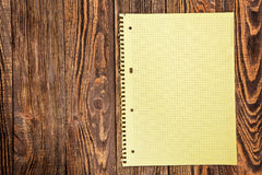 Notepad on a wooden table Stock Photography