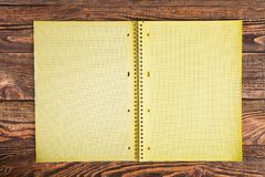 Notepad on a wooden table Stock Photos