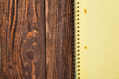 Notepad on a wooden table Stock Images