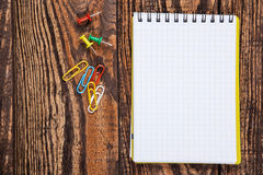 Notepad on a wooden table Royalty Free Stock Image