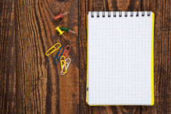 Notepad on a wooden table Royalty Free Stock Photo