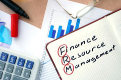 Notepad with word FRM finance resource management concept. Stock Photo