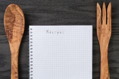 Notepad with word recipe on wood table with Royalty Free Stock Photos