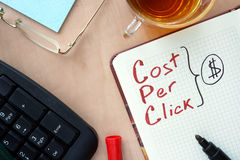 Notepad with words CPC cost per click  concept and marker. Royalty Free Stock Photo