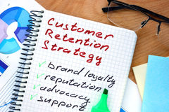 Notepad with words customer retention strategies. royalty free stock images