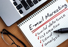 Notepad with words e-mail marketing.    Advertising concept Royalty Free Stock Photos