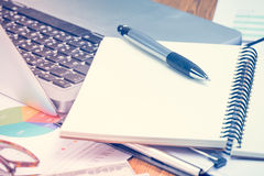 Notepad on working desk. Royalty Free Stock Photos