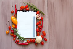 Notepad for writing prescriptions with fresh vegetables. Royalty Free Stock Images